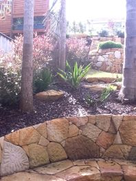 Tropical garden with retaining wall